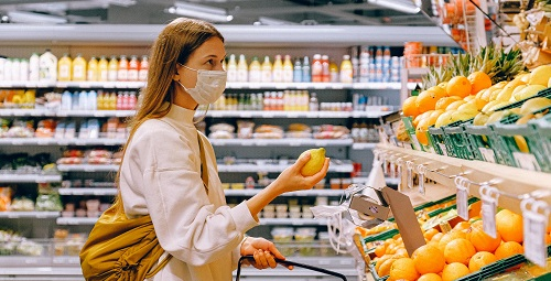 Woman wearing a face mask at supermarket
